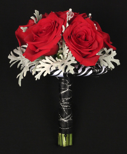 [Image: This prom bouquet features beautiful red flowers with unique red ribbon to finish it off.]
