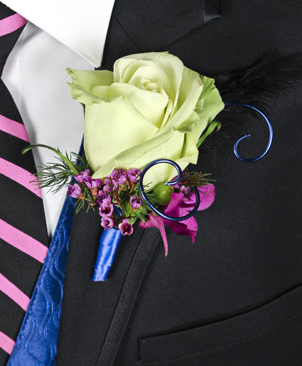 This prom boutonniere is so fun with the light green tinted rose, accents of purple flowers and the blue wire and ribbon.