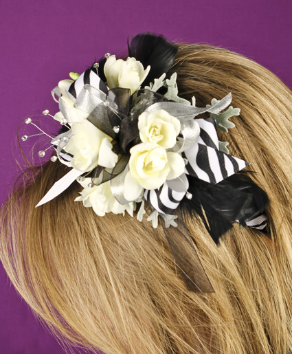 This fun black and white floral head band features white flowers with black and white printed ribbon and feathers. Such a fun added detail to any prom dress.