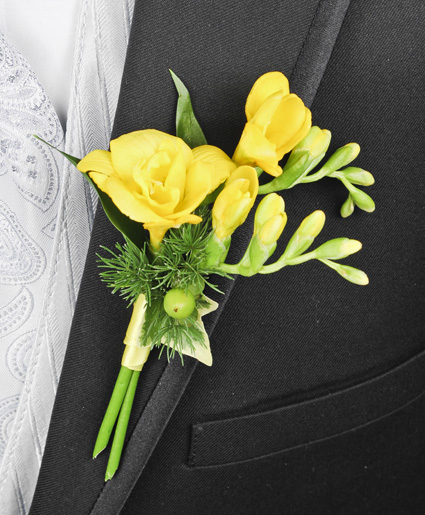 This yellow and green boutonniere features beautiful yellow flowers with hints of green accents.